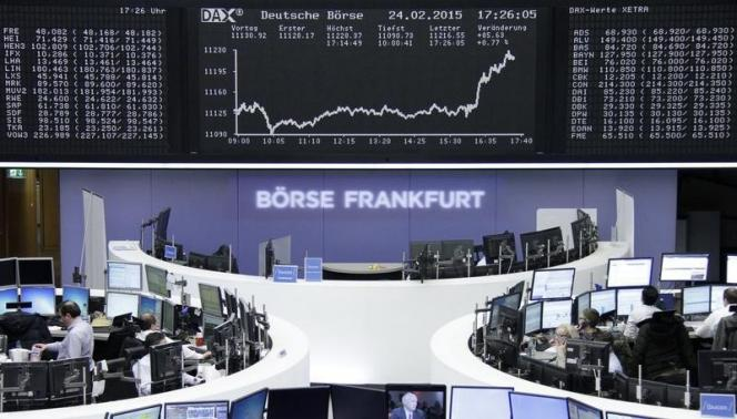 World stocks near all-time highs after Fed signals