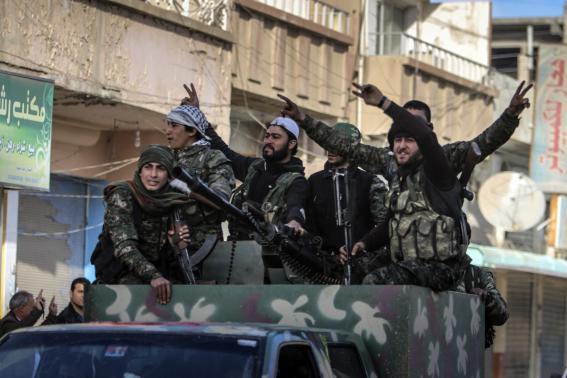 Islamic State under pressure as Kurds seize Syrian town
