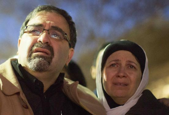 U.S. gunman kills three young Muslims; motive disputed
