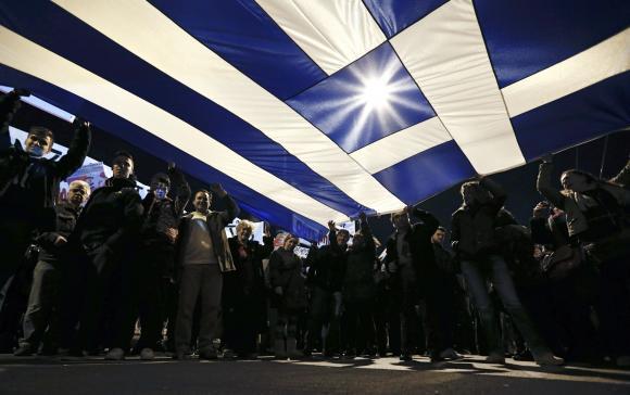 Greece, confident as EU meeting looms, sticks to no-austerity pledge
