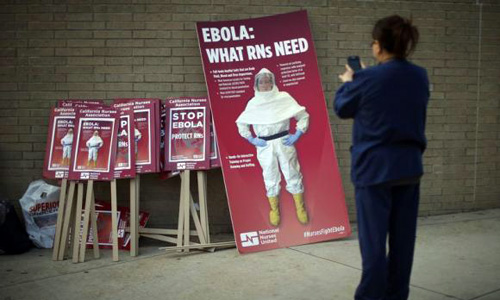 Ebola drug in Guinea helps some, stirs debate on broader use