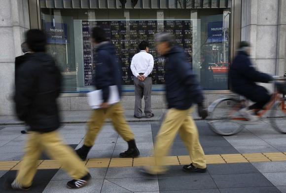 Tokyo shares at eight-year top, Greek talks loom