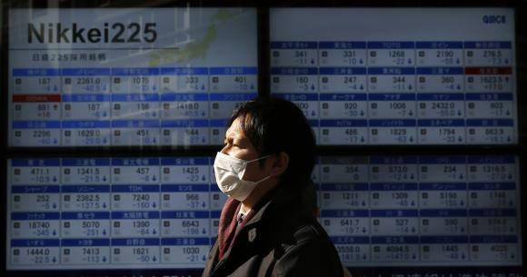 Asia stocks, euro hit as ECB takes hard line on Greek debt