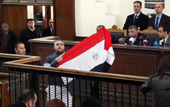 Egypt frees two Al Jazeera journalists on bail