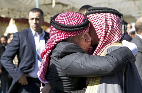Jordan military jets pound Islamic State as king comforts pilot's family