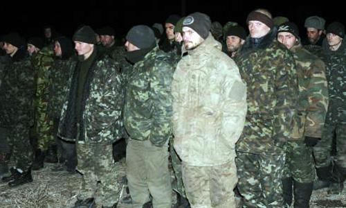 Ukraine, pro-Russia rebels swap dozens of prisoners