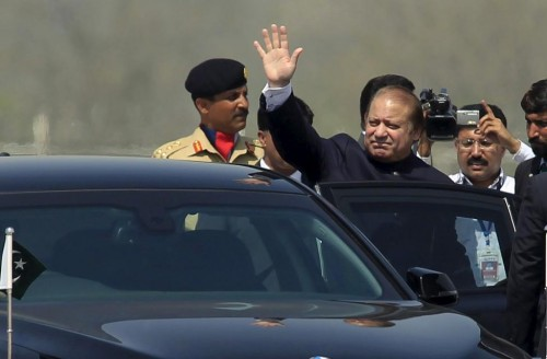 Prime Minister Nawaz Sharif waves after attending the Pakistan Day parade in Islamabad March 23, 2015.