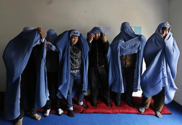Afghan men don burqas, take to the streets for women's rights