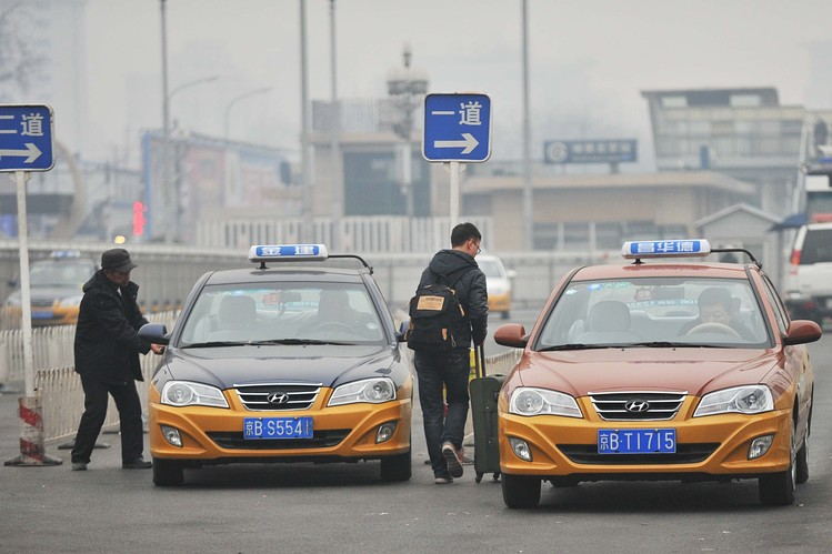 China's Renaissance man nabs taxi ride ahead of foreign rivals