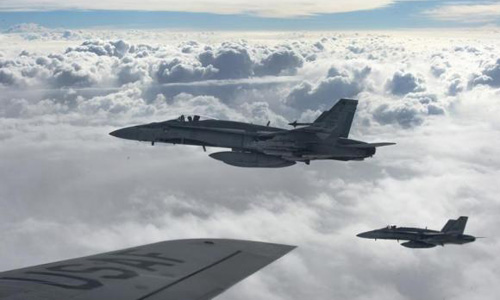 Canada says it will bomb Islamic State 'safe havens' in Syria