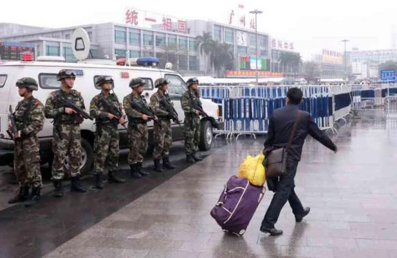 Knife attack wounds 9 at Chinese train station, suspect shot dead