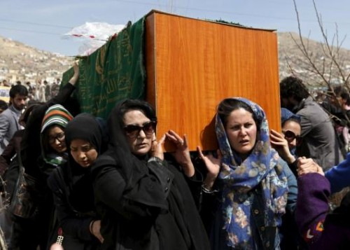 Afghan women's rights activists carry the coffin of Farkhunda, an Afghan woman who was beaten to death and set alight on fire on Thursday, during her funeral ceremony in Kabul March 22, 2015.