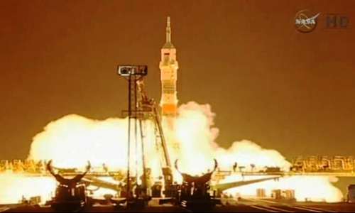 US-Russian crew reaches space station for year-long stay