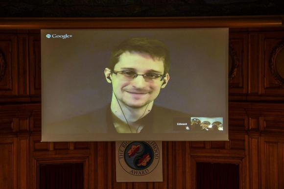 Snowden says US not offering fair trial if he returns