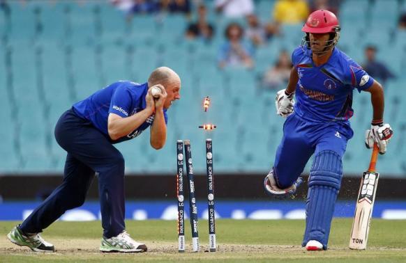 England beat Afghanistan in rain-swept Sydney