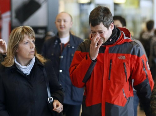A family member of a passenger feared killed in Germanwings plane crash reacts as he arrives at Barcelona's El Prat airport March 24, 2015. REUTERS