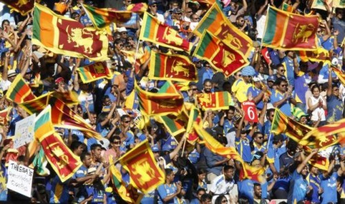Fans of Sri Lanka's World Cup cricket team cheer on their batsmen during their Cricket World Cup match against Bangladesh at the MCG in Melbourne, February 26, 2015.
