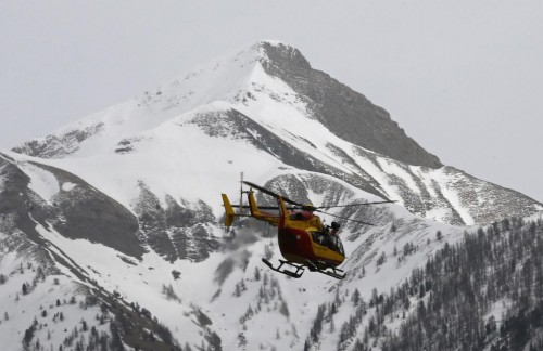 A rescue helicopter from the French Securite Civile flies over the French Alps during a rescue operation after the crash of an Airbus A320, near Seyne-les-Alpes, March 24, 2015.