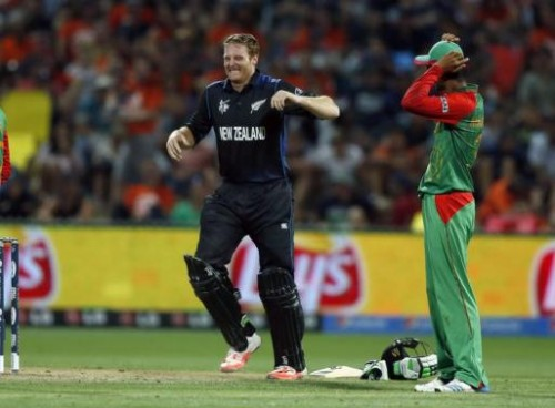 New Zealand's Martin Guptill grimaces with cramp just before making a century. –Reuters
