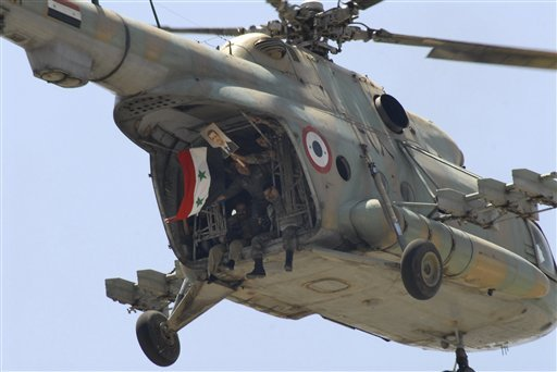 Syrian army helicopter crashes; crew captured by rebels