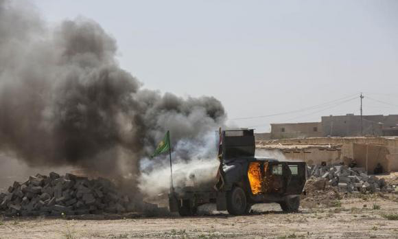 US-led coalition, Iraqis pound Islamic State in Tikrit