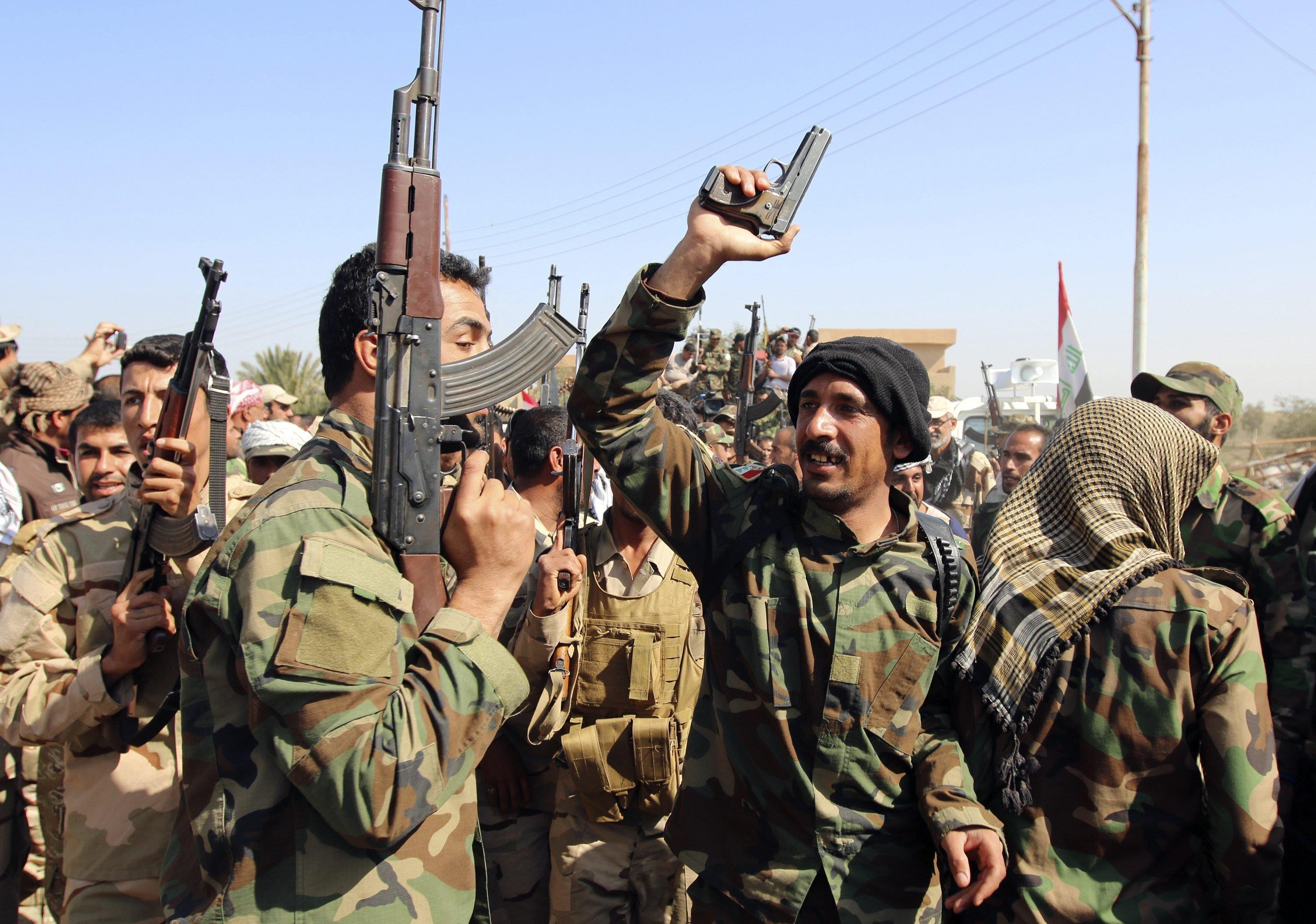 Iraq army, Shi'ite militias attack IS strongholds north of Baghdad
