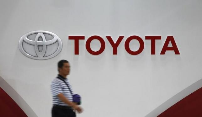 In among the robots, veteran Toyota staffer says manual labor is key to success