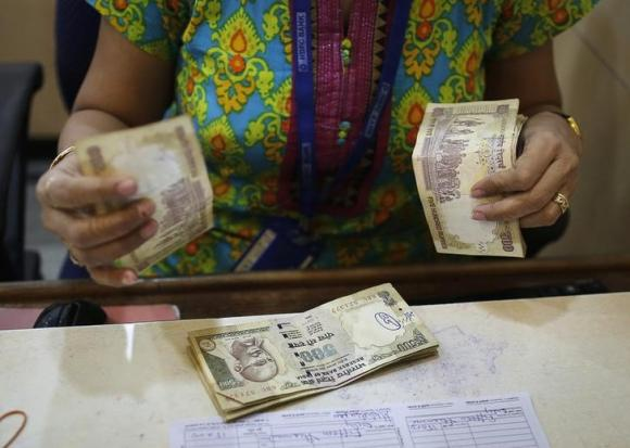 Indian rupee hits one-month high after surprise rate cut
