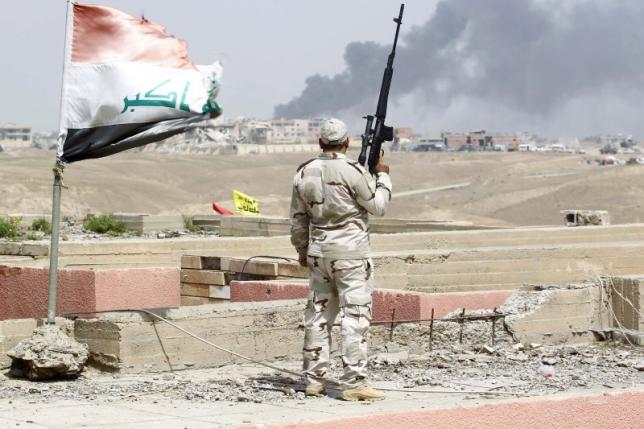 Iraqi forces seize government headquarters in battle for Tikrit