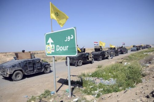 Members of Iraqi security forces and Shiite militia fighters make their way in vehicles from Samarra to the outskirts of Tikrit, north of Baghdad, February 28, 2015.