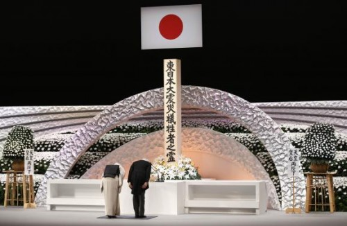 Japan's Emperor Akihito (R) and Empress Michiko bow in front of the altar for the victims of the March 11, 2011 earthquake and tsunami at the national memorial service in Tokyo March 11, 2015.
