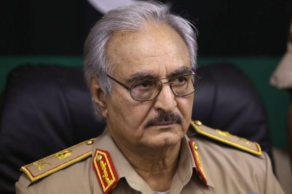Libyan general sworn as top commander as his planes hit Tripoli airport