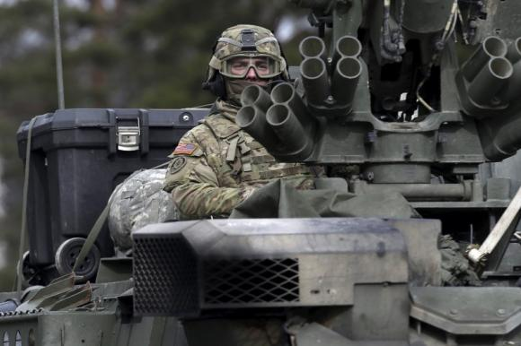 Kremlin urges France, Germany to push Ukraine more on peace deal
