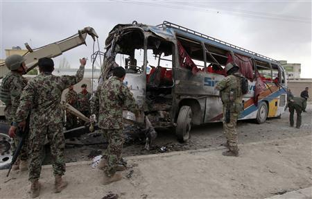 Masked gunmen kill 13 Afghans in third bus attack in a month
