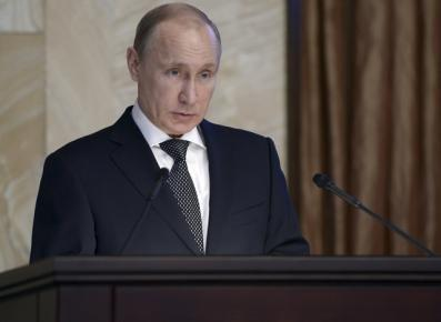 Putin says Western spies plot against Russia before polls