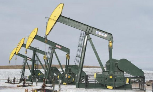 Oil rises more than 1 percent, boosted by weaker dollar