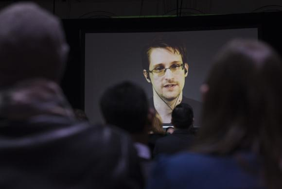 Fugitive ex-US spy Snowden in talks on returning home: lawyer
