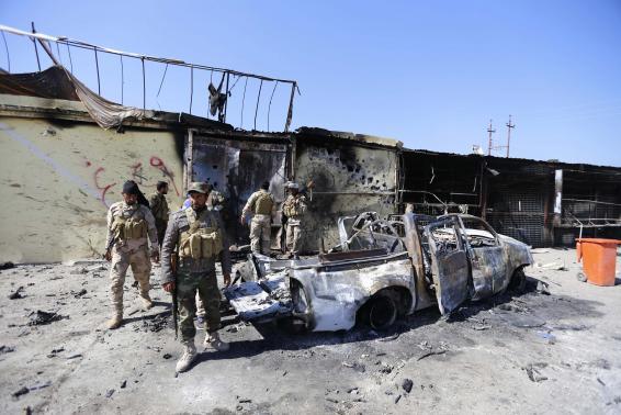 Iraqi forces push into Tikrit, bombers hit Ramadi