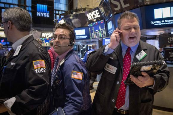 Wall St. gains on deal activity, energy shares rally