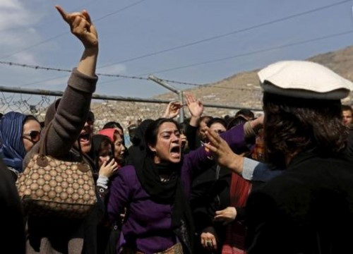 Afghan women's rights activists chant slogans during the funeral ceremony of Farkhunda, an Afghan woman who was beaten to death and set alight on fire on Thursday, in Kabul March 22, 2015.
