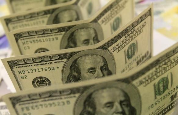 Dollar powers to fresh highs; stocks and oil fall