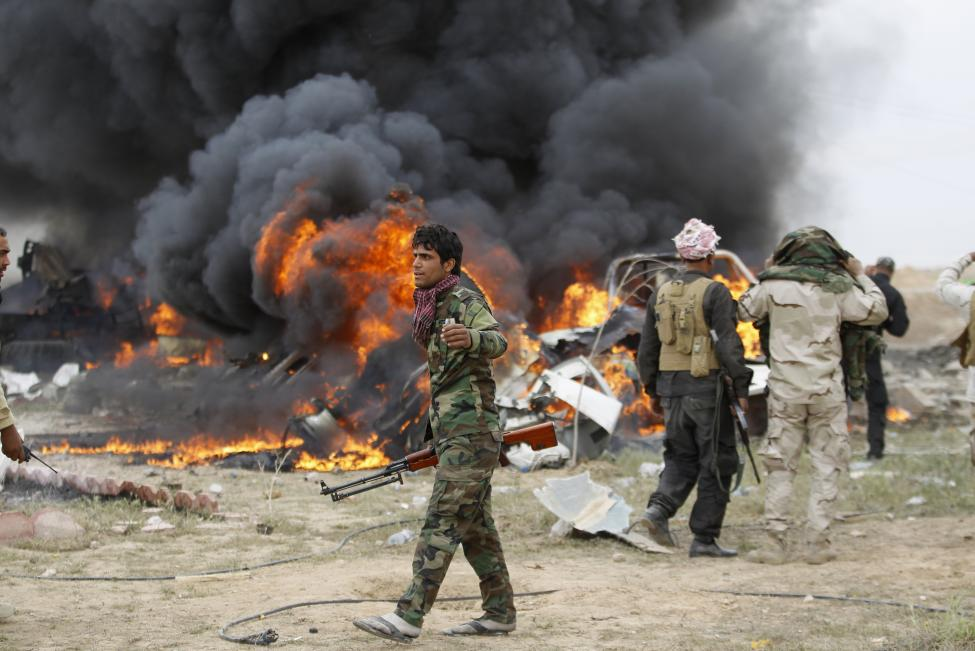 Iraqi forces slowed by snipers and bombs in Tikrit