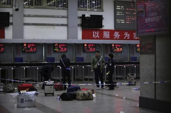 China executes three men convicted in mass stabbing at train station