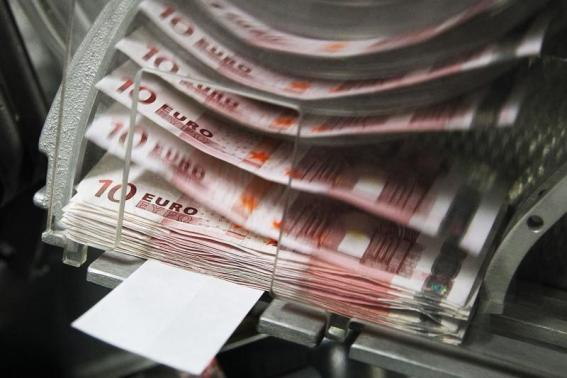 Strong euro zone business data sends euro, shares higher