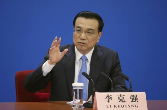 China Premier says won't be easy to grow economy by 7 pct in 2015