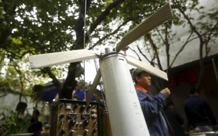 A missile from a U.S. helicopter which was used during the Vietnam War is seen displayed for sale at an old items market in Hanoi