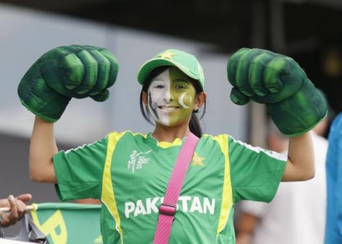 A Pakistani fan shows her muscles before the World Cup match in Auckland. –Reuters