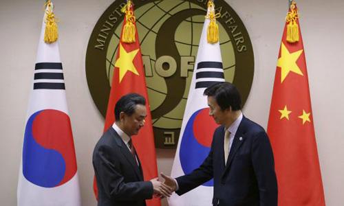Top South Korea, Japan, China envoys aim to damp tension, discuss missiles, regional bank