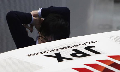 Asian shares edge lower as Wall St hit by Fed nerves
