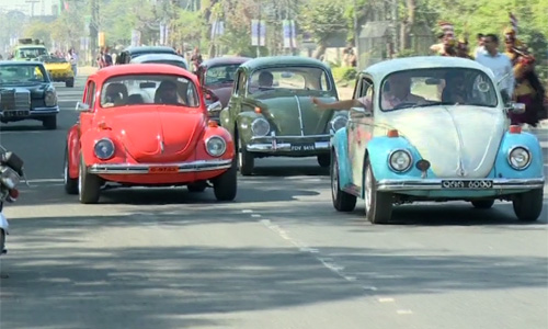 Antique cars participate in the full dress rehearsal for the Azm-e-Pakistan Parade.